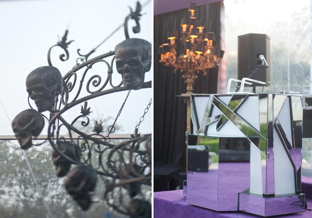 black wrought iron skull chandelier and mirrored dj stand