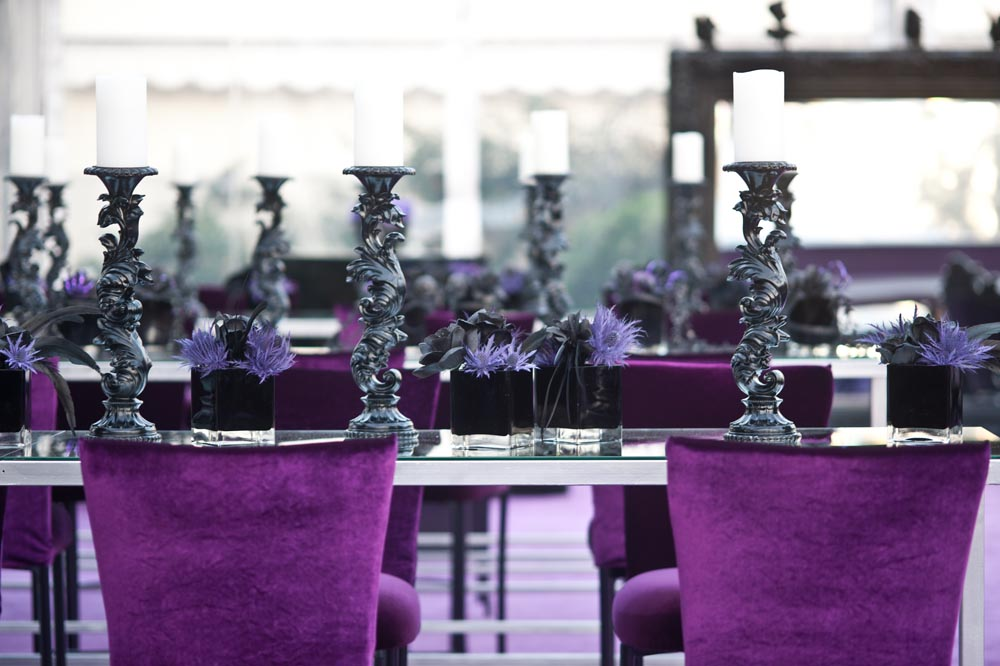 purple velvet dining chairs and black gothic candleholders