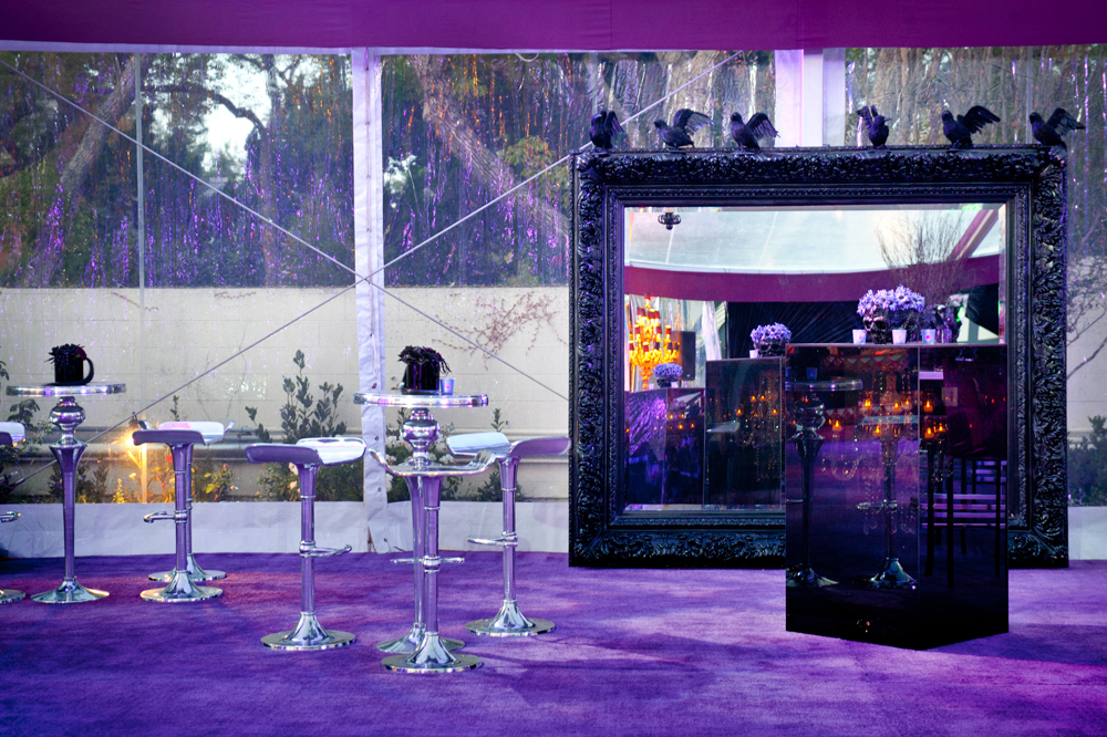 silver cocktail tables and chairs, purple carpet, black mirror