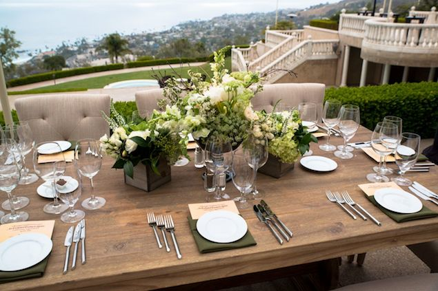 Wood Table with Green and White Floral Centerpieces